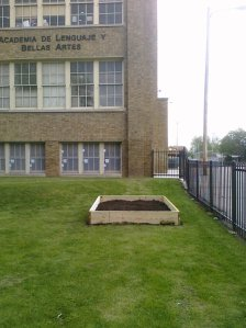 A new 6 feet long by 8 feet wife by 1 foot wide raised bed that was built on 6 May 2010 at ALBA School in Milwaukee.